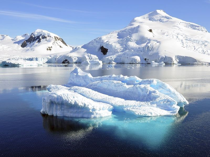 antarctic icebergs through the clear blue ocean antarctica