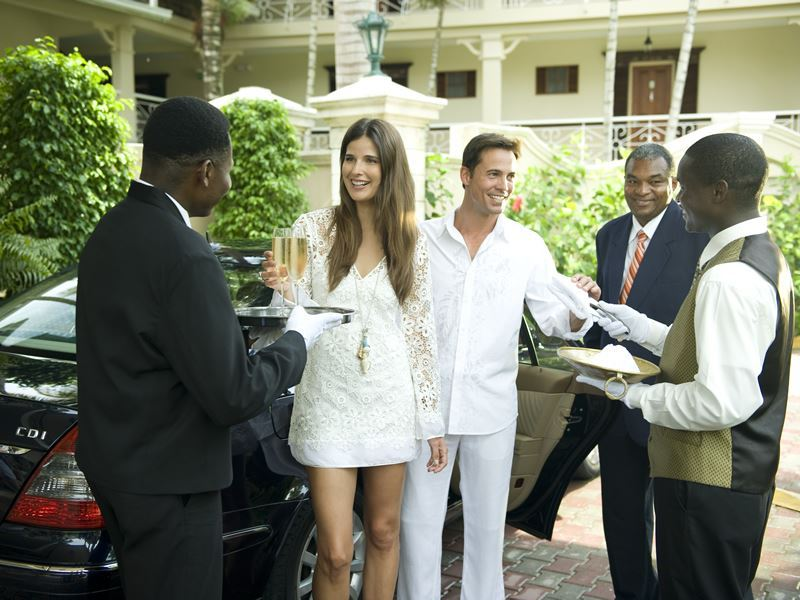 butlers greet you with lemongrass scented hand towels and welcome drink