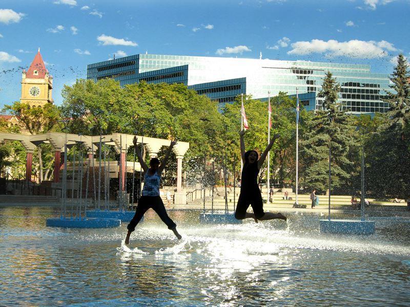 enjoying olympic plaza calgary in the summer
