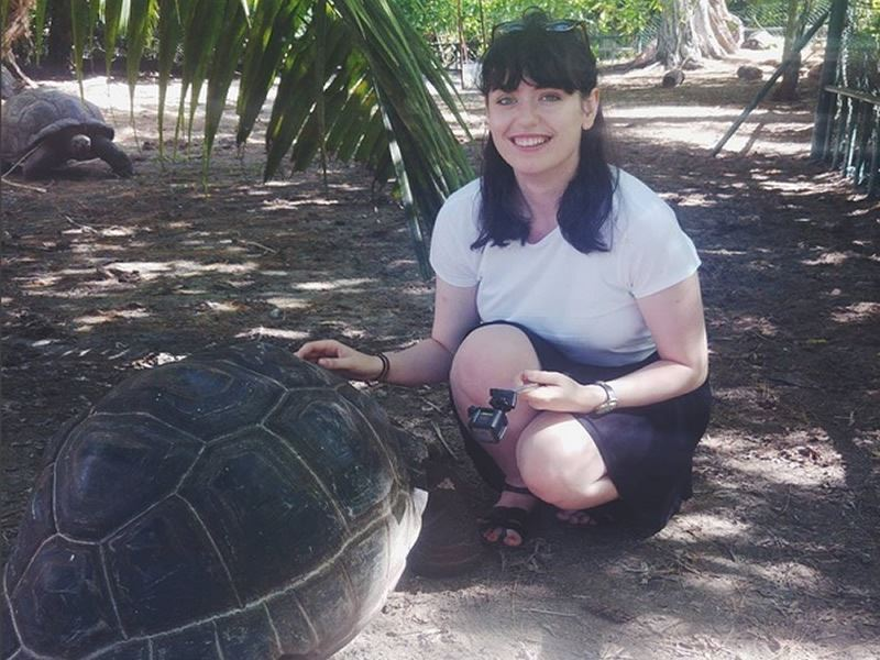hazel with toby the giant tortoise in the seychelles