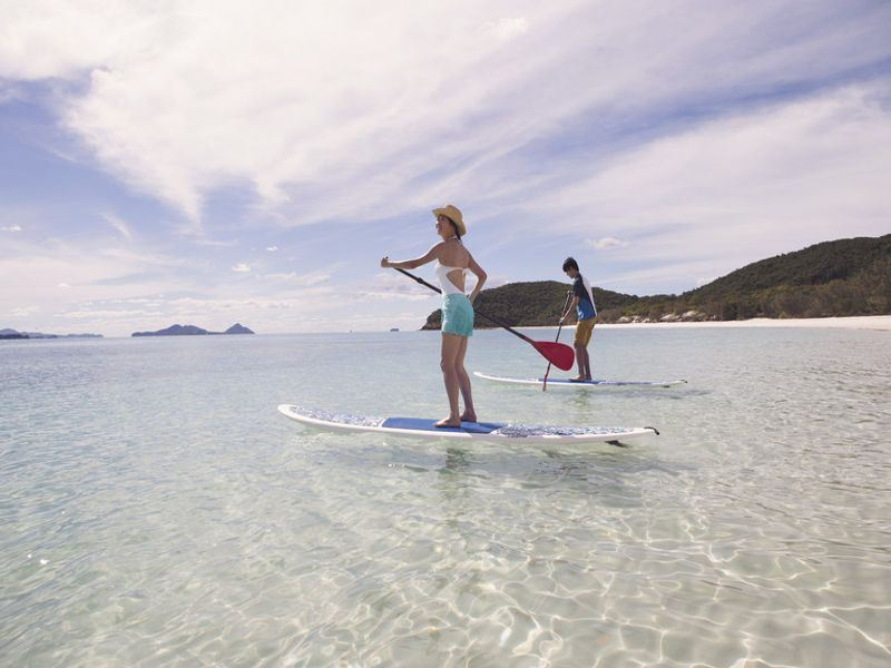 paddleboarding at hamilton island   tourism australia