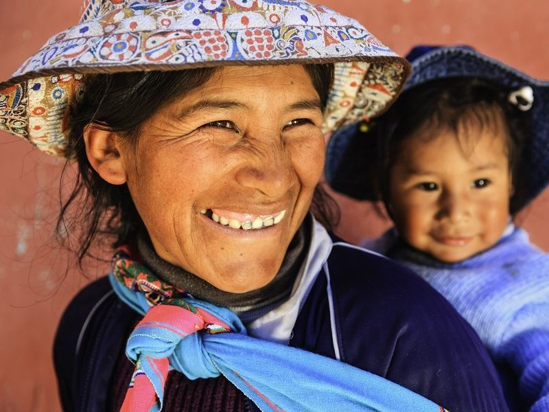 peruvian women with child inca trail