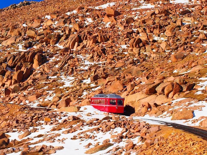 pikes peak train on mountain colorado