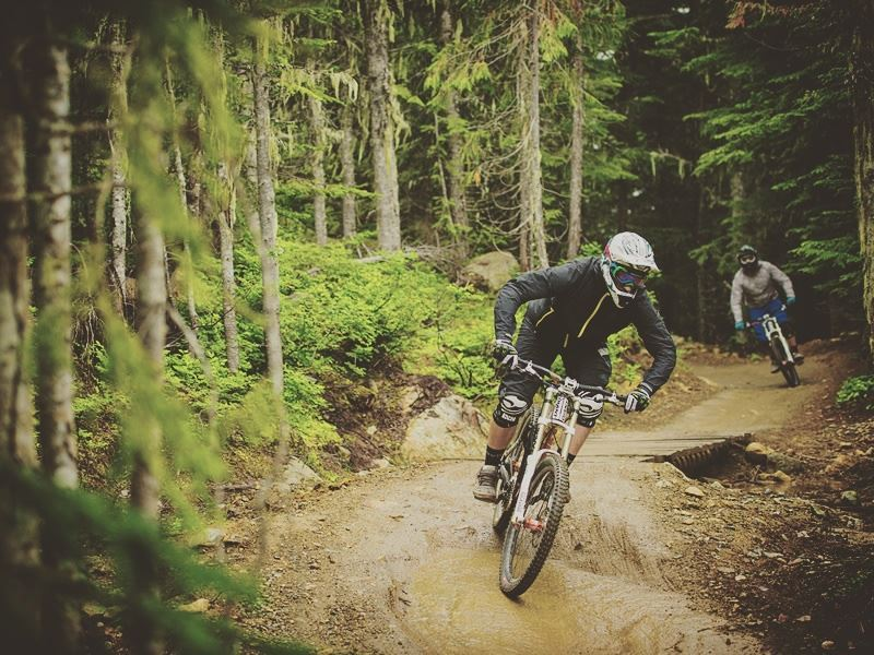 riding the b line at whistler mountain bike park