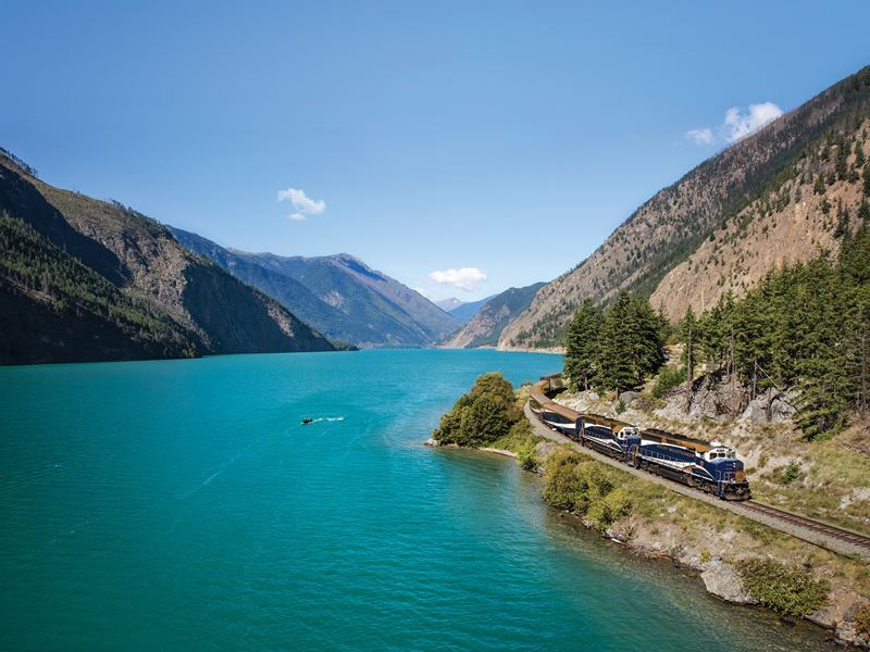rocky mountaineer travelling past seton lake on the rainforest to gold rush route