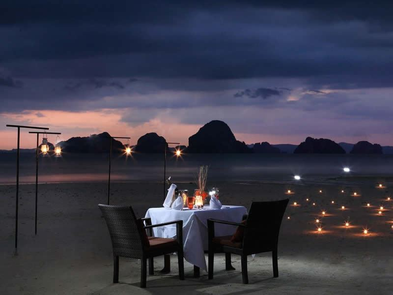 romanic dining on a beach setting amari vogue krabi