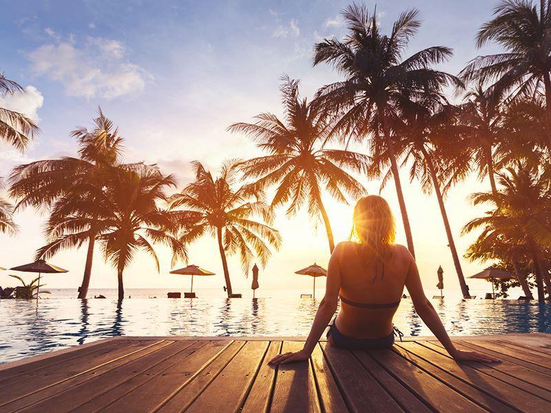 single woman by tropical pool