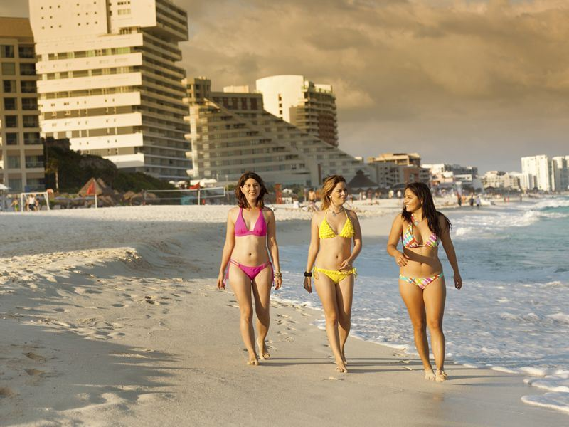 women on the beach in cancun